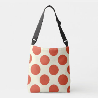 Large red polka dots design on cream crossbody bag