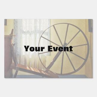 Large Spinning Wheel Near Lace Curtain Yard Sign