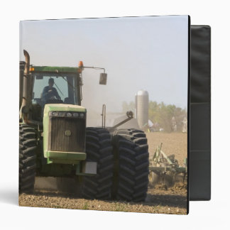 Large tractor cultivating spring soil on a vinyl binders