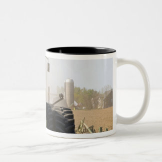 Large tractor cultivating spring soil on a Two-Tone coffee mug