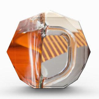 Large transparent glass mug with tea close up acrylic award