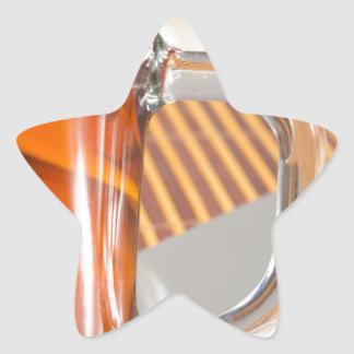 Large transparent glass mug with tea close up star sticker