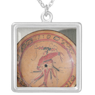 Large tripodal dish depicting an actor or dancer square pendant necklace
