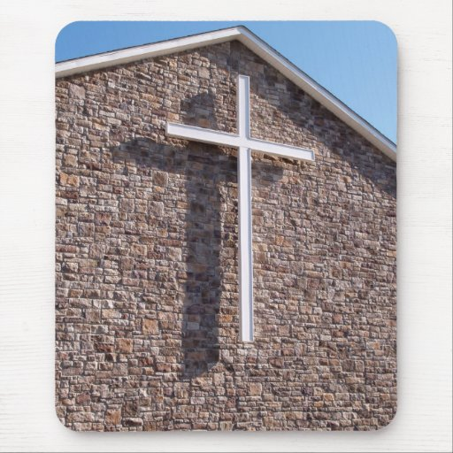 large white cross on a church stonewall mouse pads