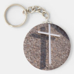 large white cross on a stonewall key chains