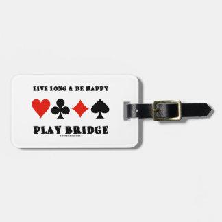 Largo vivo y sea puente feliz del juego cuatro ju etiquetas de maletas