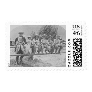 Larry Larom with six children Stamp