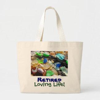 Las bolsas de asas cariñosas jubiladas de la playa