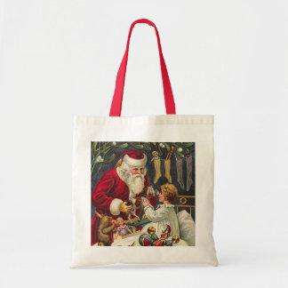 las bolsas de asas del navidad del vintage