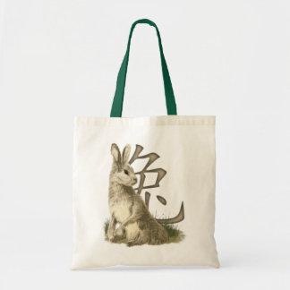 Las bolsas de asas del símbolo del conejo y del