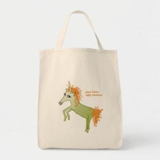 Las bolsas de asas del unicornio feo
