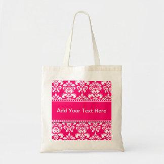 Las bolsas de asas rosadas y blancas del damasco a
