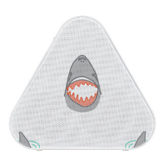 Las cabezas y las aletas del tiburón en gris en altavoz bluetooth