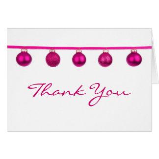 Las chucherías rosadas en navidad de la cinta le a felicitaciones