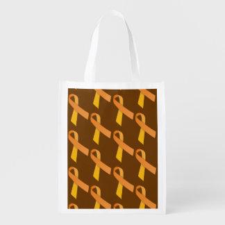 Las cintas anaranjadas tejaron el modelo bolsas de la compra