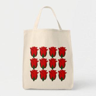 Las docena bolsas de asas de los rosas rojos