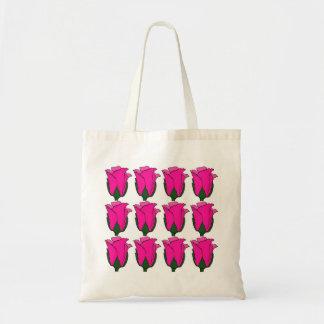 Las docena bolsas de asas rosadas de los rosas