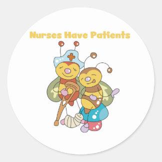 Las enfermeras tienen pacientes pegatina redonda
