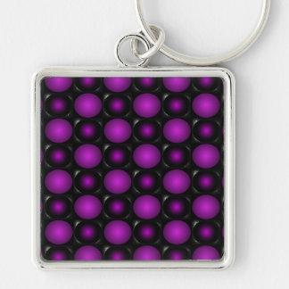Las esferas negras y púrpuras 3D texturizaron dise Llavero