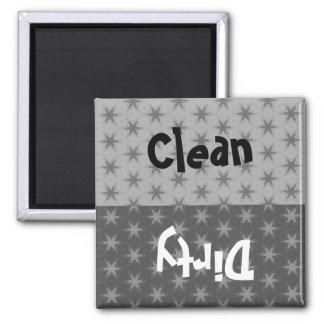 Las estrellas de la plata y del gris limpian el iman de frigorífico