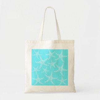 Las estrellas de mar modelan en turquesa y blanco bolsas