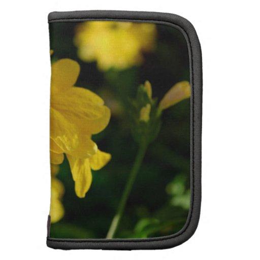 las flores amarillas se cierran encima de imagen f planificador
