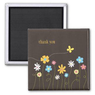 Las flores enrrolladas de la primavera le agradece iman de nevera