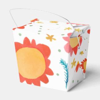 Las flores pintadas anaranjadas sacan la caja del cajas para regalos