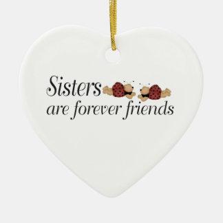 Las hermanas del navidad son para siempre amigos adorno de cerámica en forma de corazón