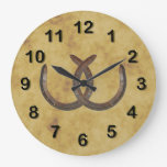 Las herraduras afortunadas rústicas apenaron el fo reloj