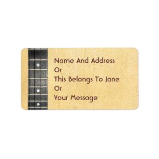 Las hojas del banjo atan las etiquetas conocidas d etiqueta de dirección