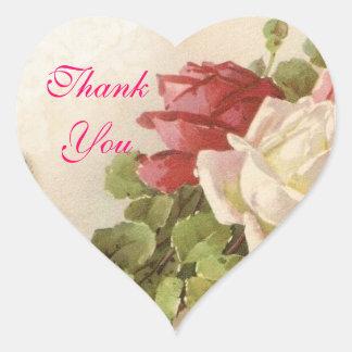 Las hojas del verde de los rosas rojos y blancos pegatina en forma de corazón