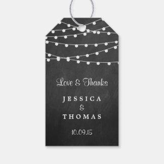 Las luces de la secuencia en la colección del boda etiquetas para regalos