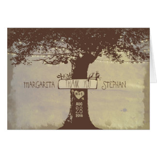 las luces lindas de la secuencia del árbol rústico felicitación