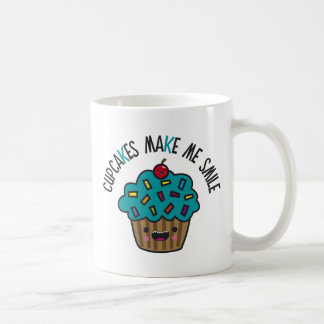 Las magdalenas hacen que sonríe taza de café
