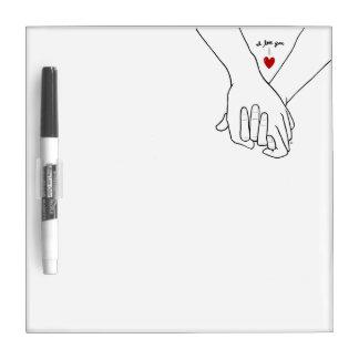 Las manos en amor secan al tablero del borrado pe pizarras blancas de calidad