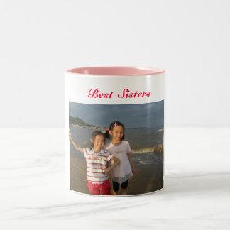 Las mejores hermanas taza de café de dos colores