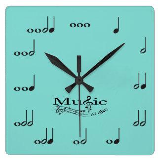 Las notas de la música con música son el decir de  reloj cuadrado