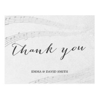Las notas elegantes de la música le agradecen postales