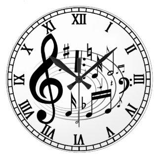 Las notas musicales negras en diseñador oval de la relojes