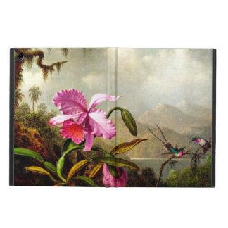 Las orquídeas y los colibríes acercan a un lago mo