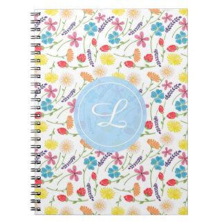 Las pequeñas flores coloridas libros de apuntes con espiral