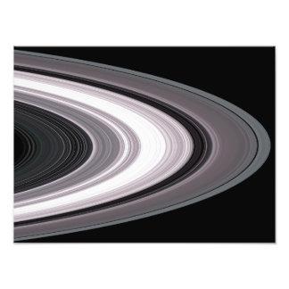 Las pequeñas partículas en el ½ s del ¿Â de Saturn Fotografías
