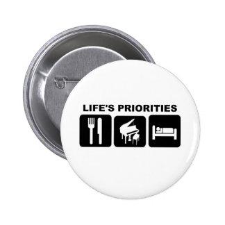 Las prioridades de la vida, música del piano pin redondo 5 cm