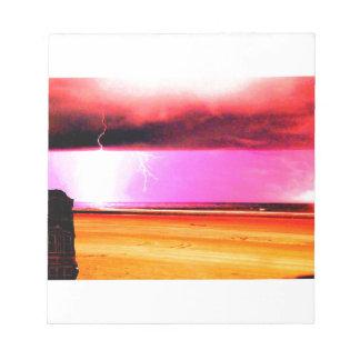 las tormentas del poder de la playa en la playa bloc de notas