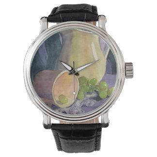 Las uvas y cubren reloj