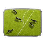 Las vacas que juegan a fútbol funda  MacBook