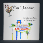 "Las Vegas Wedding Album Silver 3 Ring Binder<br><div class=""desc"">Las Vegas photo album with the famous welcome sign and iconic showgirl art on a pretty silver background makes a perfect bridal shower gift. Personalize with names of the newlyweds and date.</div>"