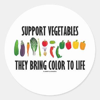 Las verduras de la ayuda traen color a la vida pegatina redonda