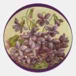 Las violetas del vintage grabaron en relieve al etiqueta redonda